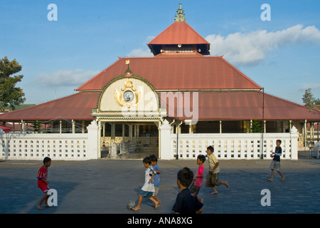 Children Play Football in front of the Great Mosque Near the Palace Yogyakarta Java Indonesia - Stock Photo