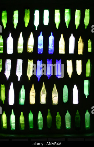 Hundertwasser toilet window at Kawakawa using old glass bottles North Island New Zealand - Stock Photo