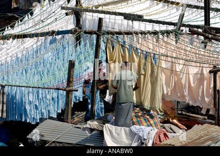Washing and laundry hanging in Dhobi Ghat, Mumbai - Stock Photo