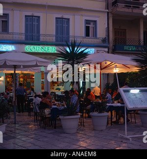 People eating out at covered tables in Platia Agiu Square at sunset in Zakynthos Town Zakynthos Island The Greek - Stock Photo