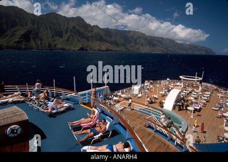 Hawaii Kauai Na Pali Coast SS Independence cruise ship passengers sunbathing - Stock Photo