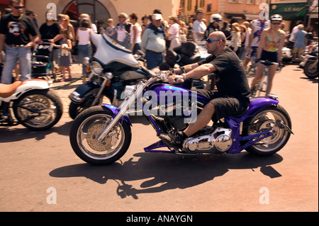 Biker riding through strets of St Tropez France - Stock Photo