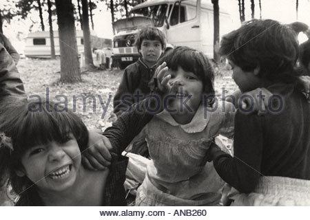 Gypsy children posing for camera - Stock Photo