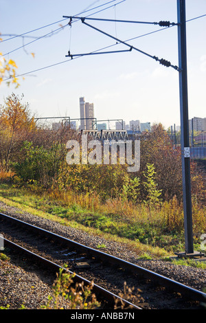 Railway line with distant Trellick Tower, North Kensington, London, England - Stock Photo