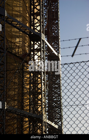 Gas storage facility (detail) with Security fence, near Ladbroke Grove, North Kensington, London, England - Stock Photo