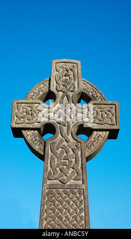Celtic cross Victorian gothic tombstone in Brompton cemetery London England - Stock Photo