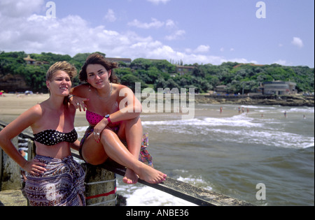 Young Girl Tourists Posing Durban Beach South Africa GPE 1024 - Stock Photo