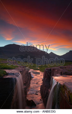 Two small creeks actually combine near the Continental Divide above Logan Pass in Glacier National Park, Montana. - Stock Photo