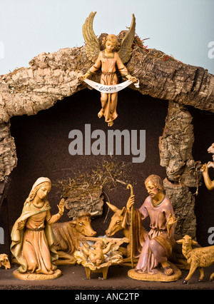 Detail of a small Christmas Neapolitan Nativity scene for domestic decoration showing the Virgin Mary Baby Jesus - Stock Photo