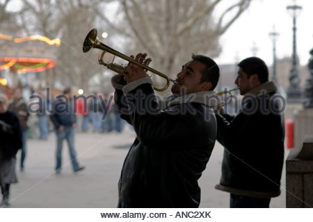 Trumpet playing Roma buskers on the South Bank London - Stock Photo