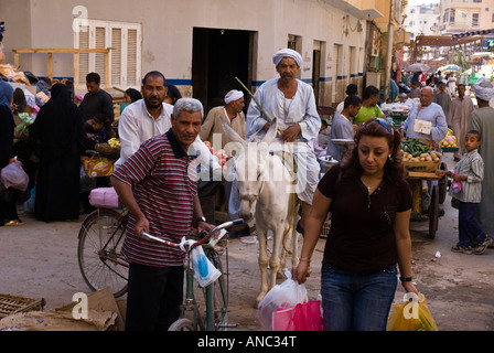 Egypt - Luxor local market souk people shopping - Stock Photo