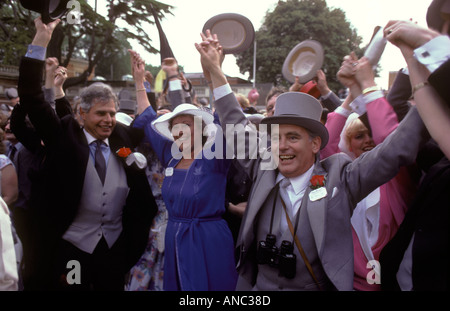 Singing around the bandstand at the end of the race day Royal Ascot  England Berkshire 1980s HOMER SYKES - Stock Photo