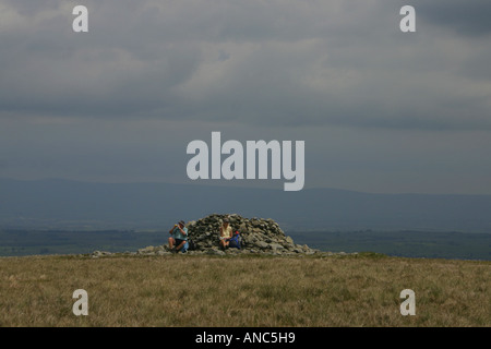 A couple at the summit of Selside Pike above Swindale in the Eastern Fells of the Lake District, Cumbria, England - Stock Photo