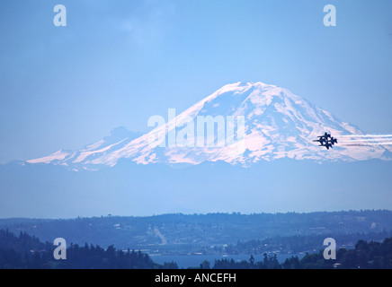 North America, USA, Washington, Seattle. The Blue Angels over Seattle at Seafair with Mt. Rainier in the background. - Stock Photo