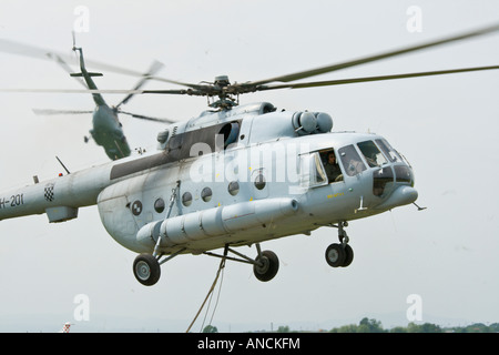 Croatian Air Force Mi-8 MTV-1 helicopters cross-crossed - Stock Photo
