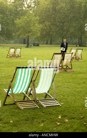 Stylised deck chairs in Green Park London - Stock Photo