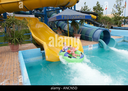 Mother and daughter water sliding on a balloon together in the Aqualand Water Park. Corfu island, Greece. - Stock Photo