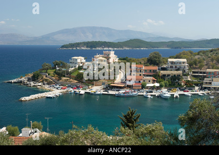 View over the town and harbour of Kassiopi from nearby Byzantine fortress. Corfu island, Greece. - Stock Photo