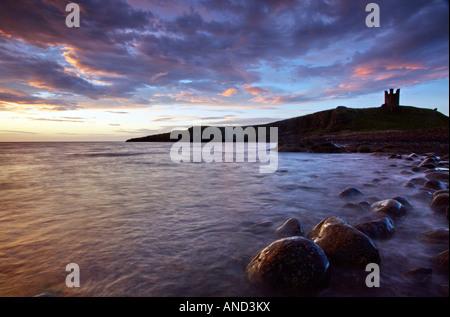 Dunstanburgh Castle At Sunrise - Stock Photo