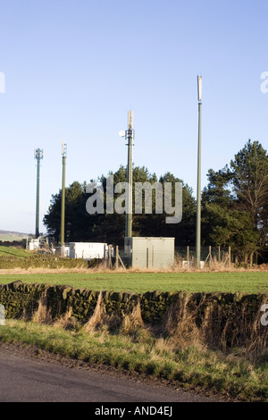 Mobile phone masts in the countryside of the Peak District in Derbyshire - Stock Photo