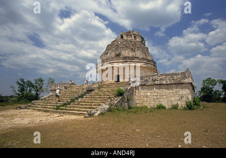 The Observatory an ancient stone temple at the ruined Mayan city of Chichen Itza in the remote forest of the Yucatan - Stock Photo