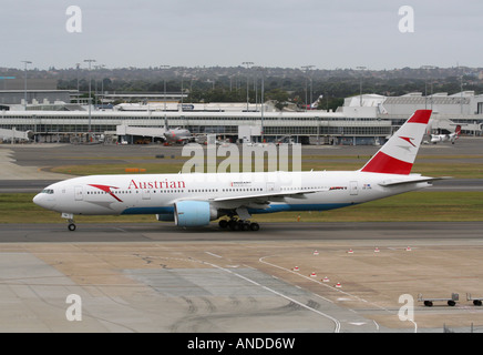 Long haul air travel. Austrian Airlines Boeing 777-200ER widebody passenger jet plane taxiing at Sydney Airport, - Stock Photo