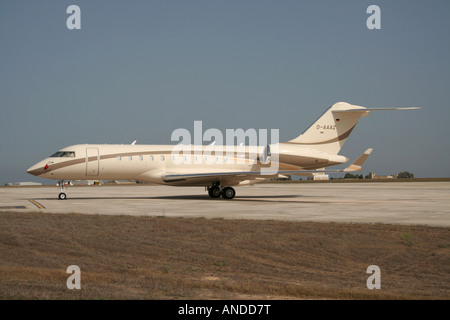 Bombardier Global Express large business jet parked on the ground. - Stock Photo