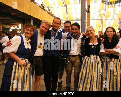 Europe Germany Munich Beer Festival Oktoberfest people dancing and drinking in tent hall and partying. - Stock Photo