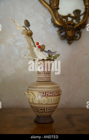 Pot with fake flowers - Stock Photo