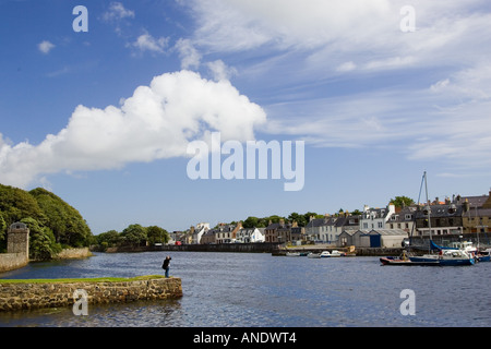 Man looks over at Stornoway harbour Outer Hebrides United Kingdom - Stock Photo