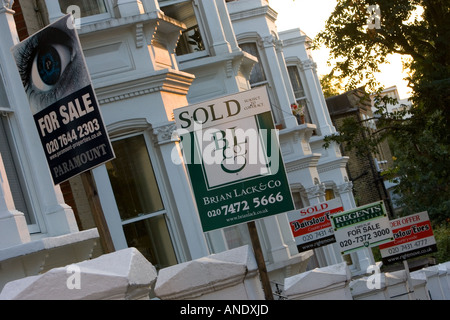 For Sale and Sold signs West Hampstead London United Kingdom - Stock Photo