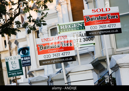 For Sale Under Offer and Sold signs West Hampstead London UK - Stock Photo