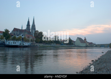 Beautiful sunset view of the ancient city of Regensburg on the Danube River Germany Western Europe - Stock Photo