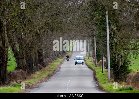 Car and motorbike on a country road Staffordshire United Kingdom - Stock Photo