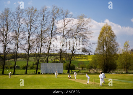 Locals play cricket Swinbrook The Cotswolds United Kingdom - Stock Photo
