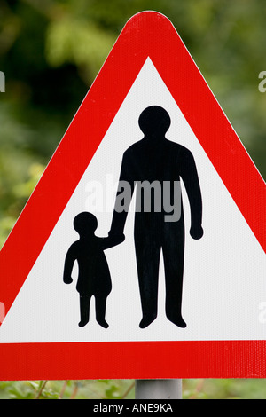 Pedestrians In Road Ahead warning sign by the road in Oxfordshire United Kingdom - Stock Photo