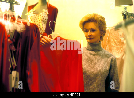 Shopping Woman in store QHTK347 - Stock Photo