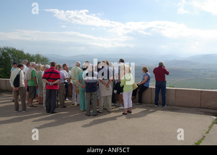 Sevastopol Sapun museum memorial complex tour group with guide at viewpoint which overlooks Battlefield of Balaklava - Stock Photo