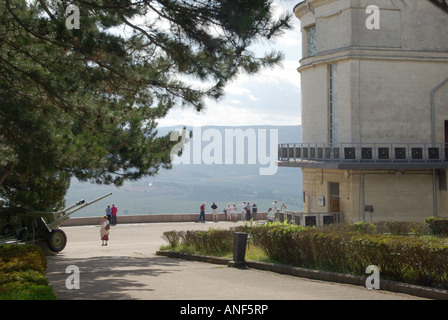 Sevastopol part Diorama museum memorial complex & tour group with people at viewpoint which overlooks Battlefield - Stock Photo