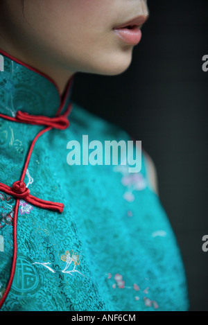 Young woman dressed in traditional Chinese clothing, cropped view of lower face and bust - Stock Photo