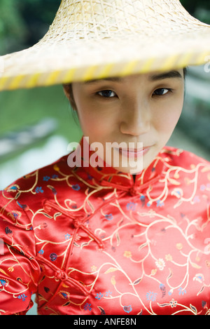 Young woman wearing traditional Chinese clothing and hat, portrait