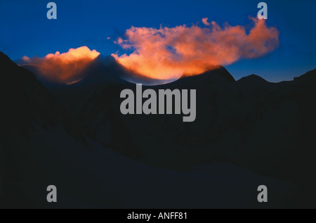 Mountainous tops are casting shadows on the clouds at sunrise the Katunskiy Range Altai Russia - Stock Photo