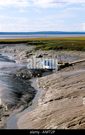 Fishing Boat stranded in mud at Low tide in Bay of Fundy near Wood Point, New Brunswick, Canada. - Stock Photo