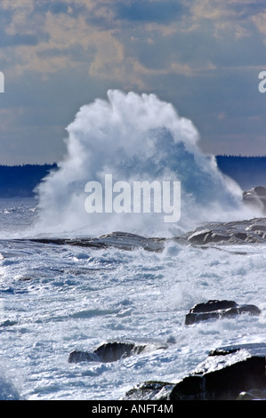 Waves breaking on rocks at Peggy's Cove during storm, Nova Scotia, Canada. - Stock Photo