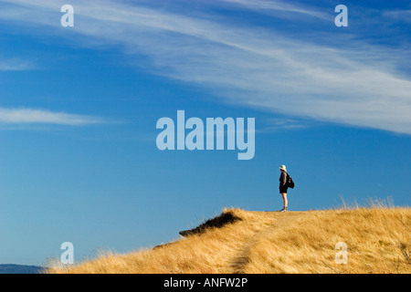 Hiker taking in the view from the East point park on Saturna Island, British Columbia, Canada. - Stock Photo