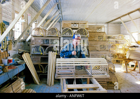 Lobster fisherman working on lobster traps, Beach Point, Prince Edward Island, Canada. - Stock Photo