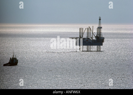 Supply ship and oil rig in Gulf of St. Lawrence, Canada. - Stock Photo