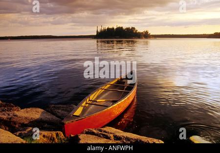 Canoe on Nutimik Lake, Whiteshell Provincial Park, Manitoba, Canada. - Stock Photo