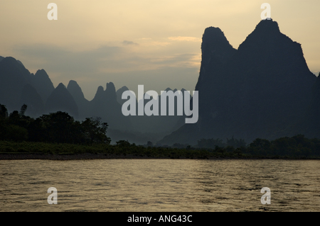 Limestone Peaks At Sunset Between Xinping And Yangshuo On Li Jiang River, China - Stock Photo