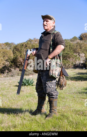 Cypriot Hunter spring migratory Bird Shooter with Shotgun in the Akamas Peninsula north-west of Pafos, Cyprus, Mediterranean. - Stock Photo